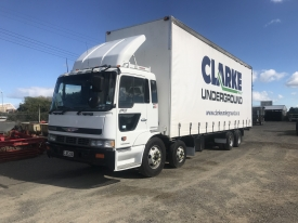 Hino 8x4 Curtain Sider with container door at rear